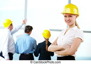 Female engineer - Portrait of engineer with yellow helmet in...