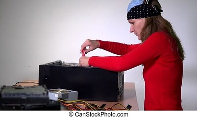 Female engineer remove computer motherboard