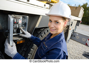 female engineer standing in front of truck