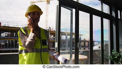 Female engineer talking on mobile phone 4k