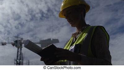 Female engineer using digital tablet 4k
