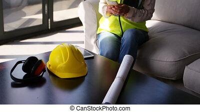 Female engineer using mobile phone 4k - Female engineer ...