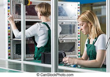 Female engineers working in factory