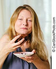 Female enjoying a chocolate brownie