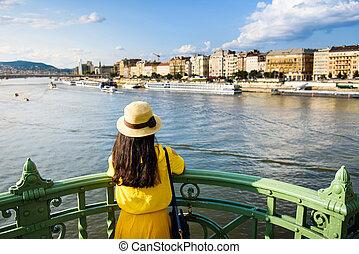 Female enjoying Budapest view from the bridge