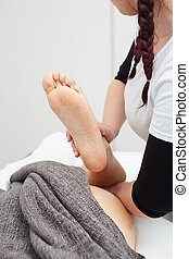 Female Enjoying Relaxing Back Massage In Cosmetology Spa Center