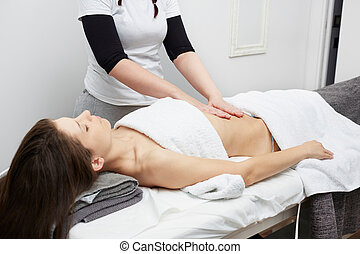 Female Enjoying Relaxing Belly Massage In Cosmetology Spa...
