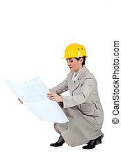 Female entrepreneur crouching on white background