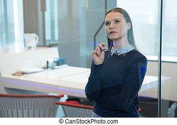 Female executive looking at digital screen