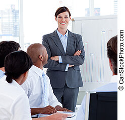 Female executive smiling at the camera