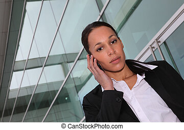 Female executive using a cellphone