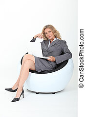 Female executive using a laptop