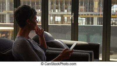 Female executive using mobile phone 4k - Female executive ...