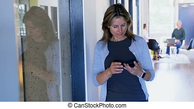 Female executive using mobile phone 4k - Female executive...