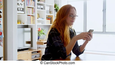 Female executive using mobile phone at office 4k