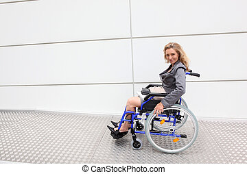Female executive using wheelchair