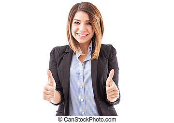 Female executive with both thumbs up