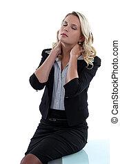 Female executive with neckache