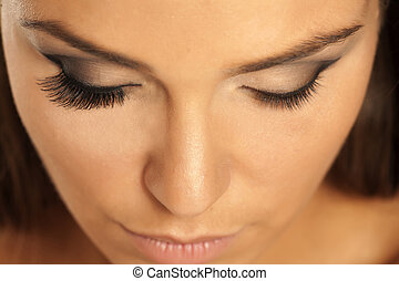 female eye with and without lash extension