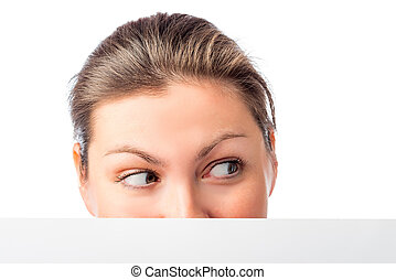 female eyes look in the direction of a white background