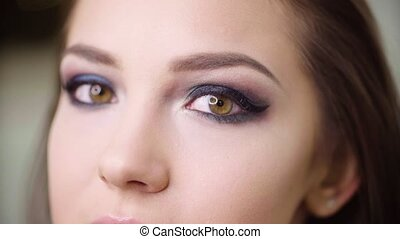 Female eyes with finished make up