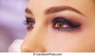 Female eyes with finished make up