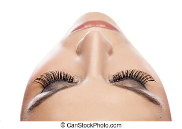 female eyes with long false eyelashes