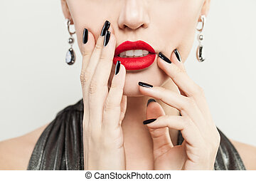 Female Face and Female Hand with Manicure. Red Makeup Lips and Black Nails Closeup