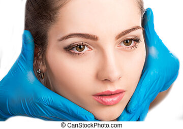 female face with beauty treatment