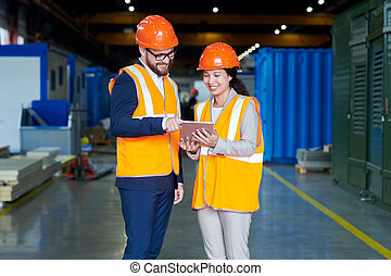 Female Factory Worker Talking to Investor