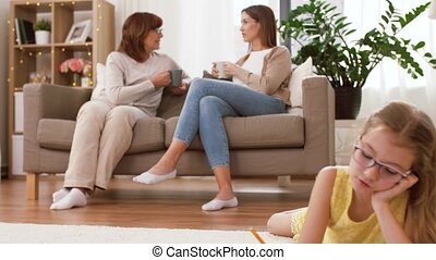 female family spending time at home - family, three...