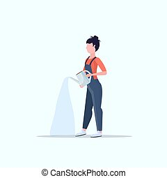 female farmer holding watering can gardener in uniform watering plants agricultural eco farming concept flat full length