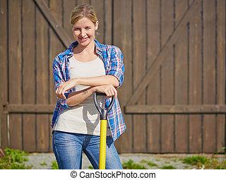 Female farmer - Image of happy female farmer with instrument...