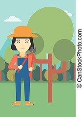 Female farmer using pruner vector illustration.