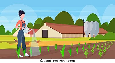 female farmer using watering can gardener in uniform watering plants agricultural planting harvesting gardening eco farming concept farmland countryside landscape flat full length horizontal