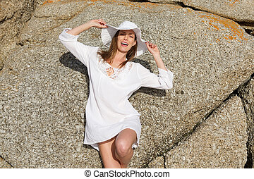 Female fashion model in summer dress and hat