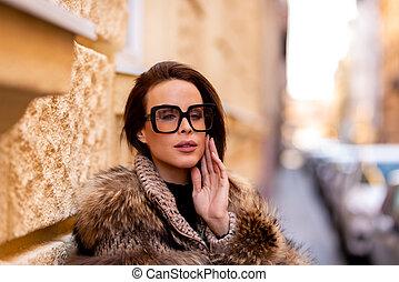 Female fashion model posing on the street