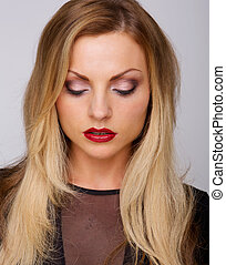 Female fashion model with red lipstick