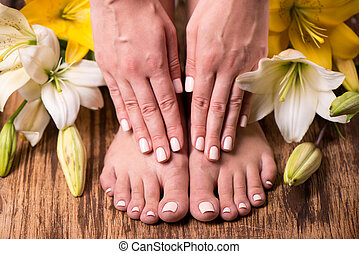 Female feet and hands after spa