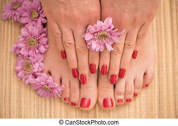 female feet and hands at spa salon - Closeup photo of a...