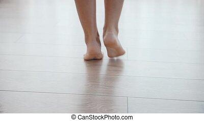 Female feet, girl wakes up