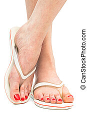 female feet in flip-flop