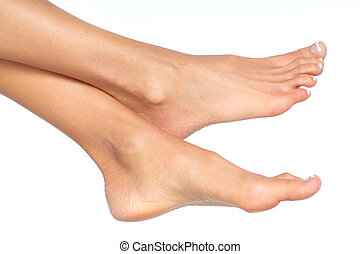 Female feet. Isolated over white background