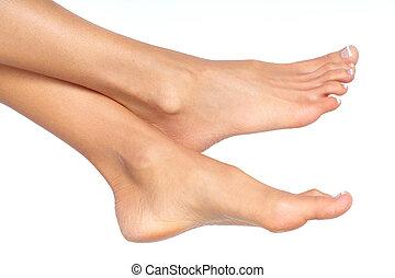 Female feet. Isolated over white background