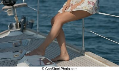 Female feet on a deck of yacht