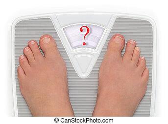 Female feet on bathroom scale with question mark symbol