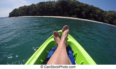 female feet relaxing on kayak sailing in pacific ocean point...