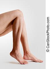 Female feet - Two female lower legs with beautiful healthy ...