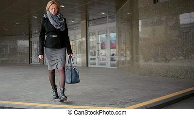 female feet walking on the street.
