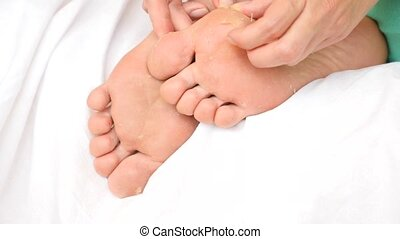 Female feet with skin peeling off. Foot peeling after the procedure. 4k. Slow motion.
